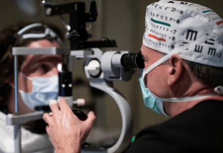 Specialist examines patient to determine if she's a candidate for LASIK eye surgery